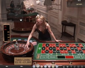 female croupier retrieving ball from wheel